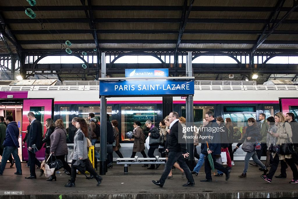 Passengers walk to take the train just arrive at Paris Saint-Lazare Train Station, Paris, France on May 31, 2016.