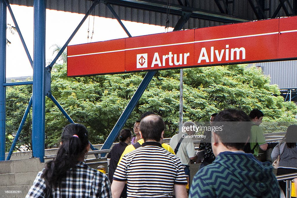 Passengers walk to the train station Arhur Alvim on January 29, 2013 in Sao Paulo, Brazil.