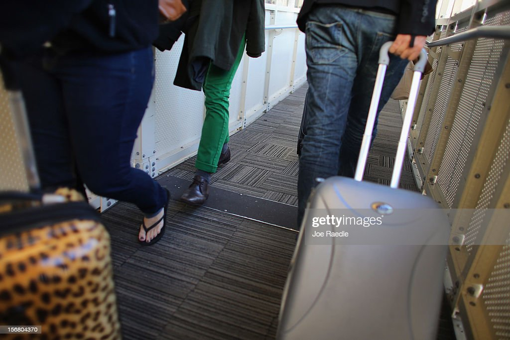 Passengers walk to their depature gates in LaGuardia Airport as they travel on the day before Thanksgiving on November 21, 2012 in New York, United States. The day before the Thanksgiving holiday is one of the busiest travel days of the year.