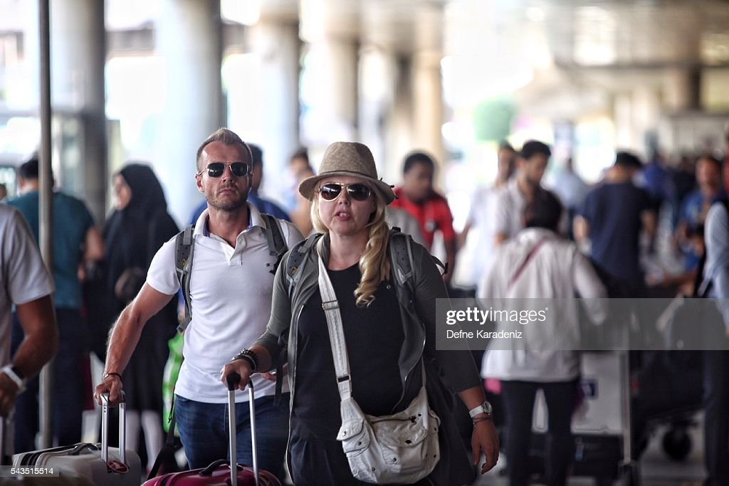 Passengers walk to their planes at Turkey's largest airport, Istanbul Ataturk, following yesterday's blasts June 29, 2016, Turkey. Three suicide bombers opened fire before blowing themselves up at the entrance to the main international airport in Istanbul, killing at least 36 people and wounding 147 people according to PM Binali Yildirim.