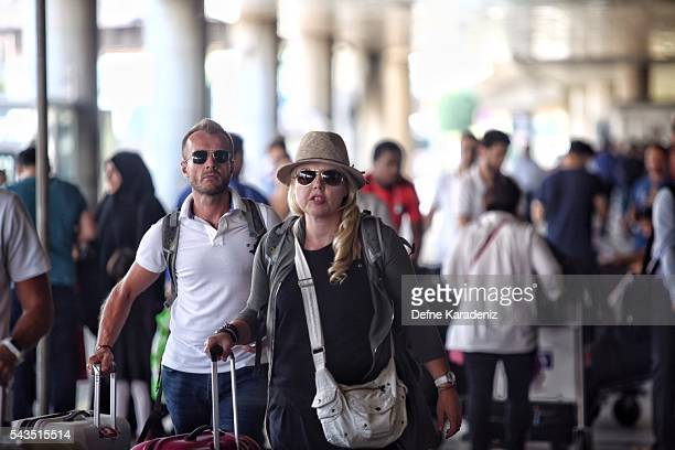 Passengers walk to their planes at Turkey's largest airport Istanbul Ataturk following yesterday's blasts June 29 Turkey Three suicide bombers opened...
