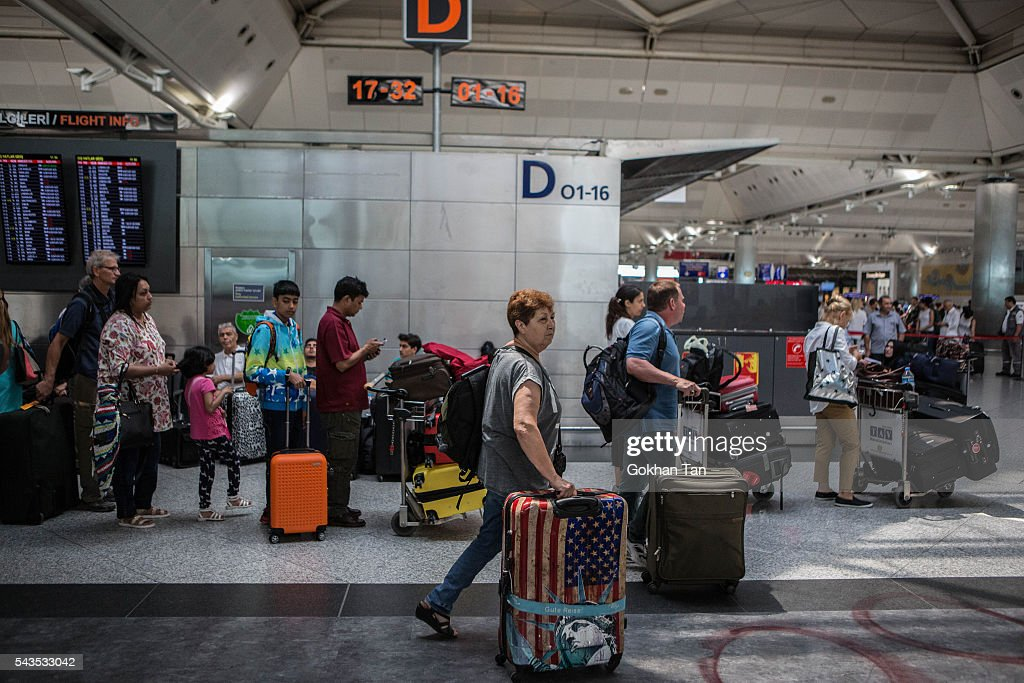 Passengers walk towards check-in counters at the country's largest airport, Istanbul Ataturk, following yesterday's blast on June 29, 2016 in Istanbul, Turkey. Three suicide bombers opened fire before blowing themselves up at the entrance to the main international airport in Istanbul yesterday. The Istanbul Governor's Office says 41 people have been killed, 37 of the victims have been identified, including 10 foreign nationals and three people with dual citizenship. More than 230 people were wounded but 109 have been discharged from hospitals in the deadly suicide bombing attack in Istanbul's Ataturk airport blamed on the Islamic State group.