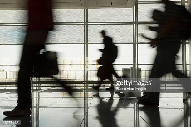 Passengers walking through an airport hall