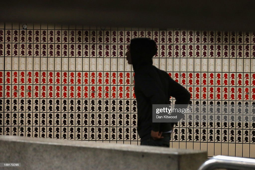 A passengers walks for a train past Sherlock Holmes themes tiles at Baker Street Underground Station on January 9, 2013 in London, England. The London Underground commonly called the Tube, is the oldest of its kind in the world, and marks it's 150th anniversary on January 10, 2013. The network carries approximately a quarter of a million people around its network of 249 miles of track every day. The Baker Street station has more platforms than any other on the network with 10, and is one of the oldest of the 270 stations on the entire network.