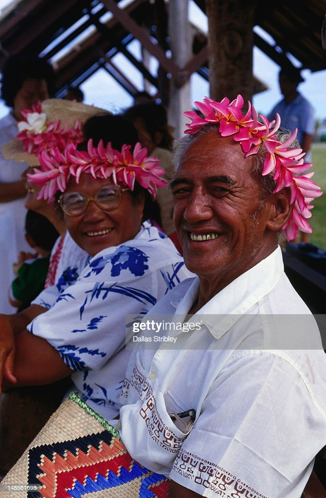 Passengers wearing frangipani leis awaiting their flight at Rarotonga airport. : Stock Photo