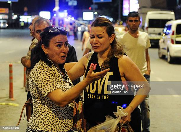 Passengers who survived from the suicide bomb attack cry as they leave the Turkey's largest airport Istanbul Ataturk June 28 Turkey Three suicide...