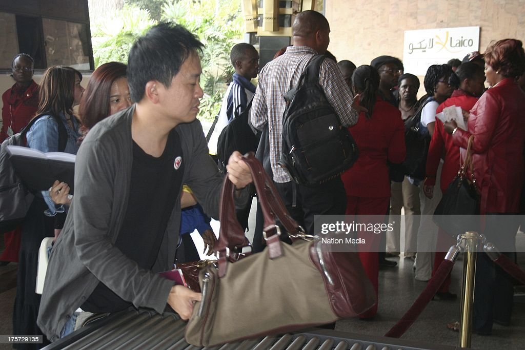 (Not for sale to The Star (Kenya), Capital FM, The People, Citizen TV, Kenya Broadcasting Corporation) Passengers who were scheduled to depart Kenya via Jomo Kenyatta International Airport check in at Laico Regency Hotel on August 07, 2013 in Nairobi, Kenya. Passengers were unable to leave after JKIA was closed indefinitely after fire gutted part of the international arrivals lobby.