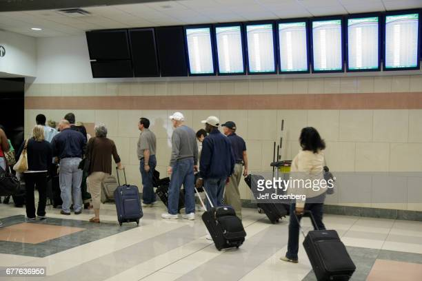 Passengers with rolling luggage at HartsfieldJackson Atlanta International Airport