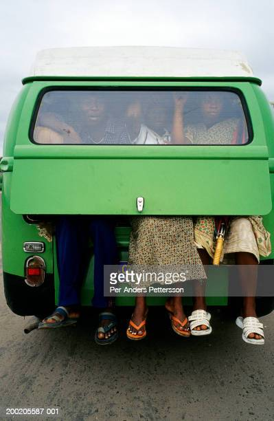 Passengers with their feet dangling out of the back of a Volkswagen kombi taxi on February 28 2002 in Kinshasa Congo The Congolese economy and...