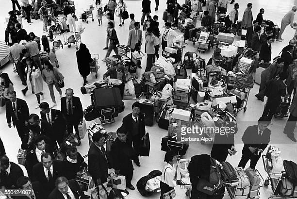Passengers with their luggage at Narita International Airport Shibayama Japan March 1988
