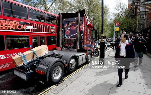 A passer by looks at a coffin tied to a lorry as part of the Transaction 2007 protest outside the Houses of Parliament London protesting against...