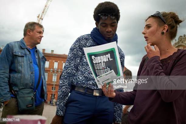 A passerby asks for information during the global Marijuana March For the Global Marijuana March supporters of legalization for medical and...
