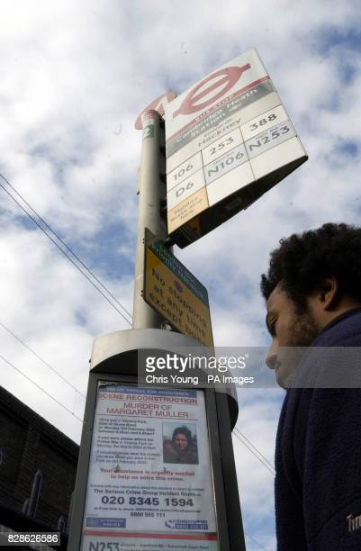 A passerby looks at a poster appealing for infomation relating to the murder of Margaret Muller posted at a bus stop in Hackney east London The...