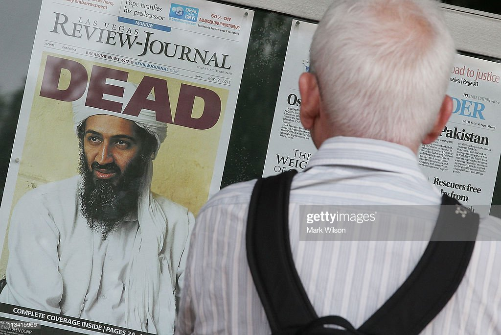 A passerby looks at newspaper headlines reporting the death of Osama Bin Laden, in front of the Newseum, on May 2, 2011 in Washington, DC. Last night U.S. President Barack Obama announced that the United States had killed the most-wanted terrorist Osama Bin Laden in an operation led by U.S. Special Forces in a compound in Abbottabad, Pakistan.