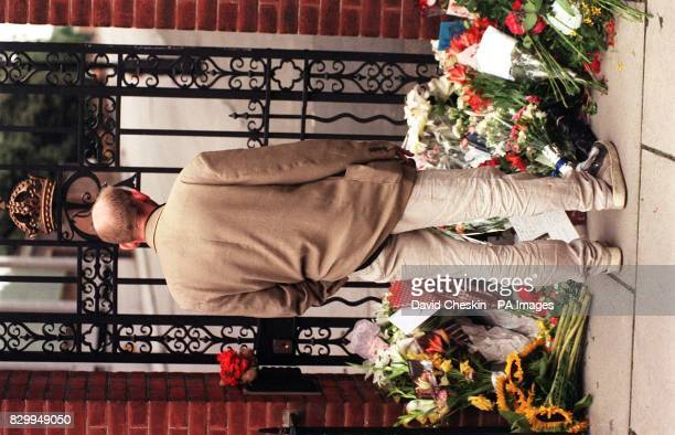 A passerby looks at the floral tributes gathering outside the gates of Kensington Palace this morning Diana Princess of Wales was killed in a car...