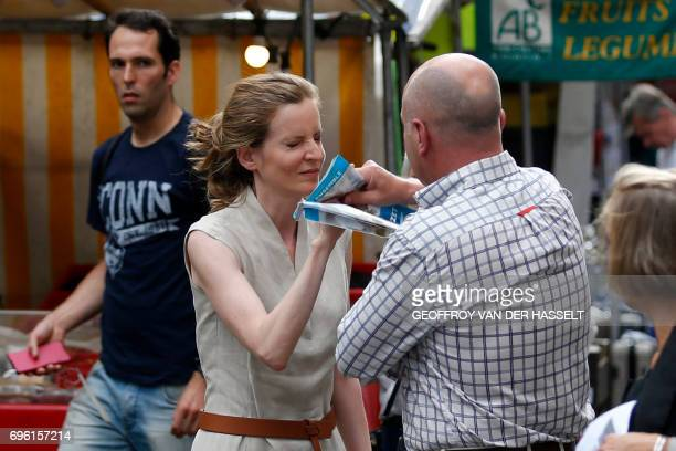 TOPSHOT A passerby takes leaflets from the hand of Les Republicains party candidate Nathalie KosciuskoMorizet during an altercation while campaigning...
