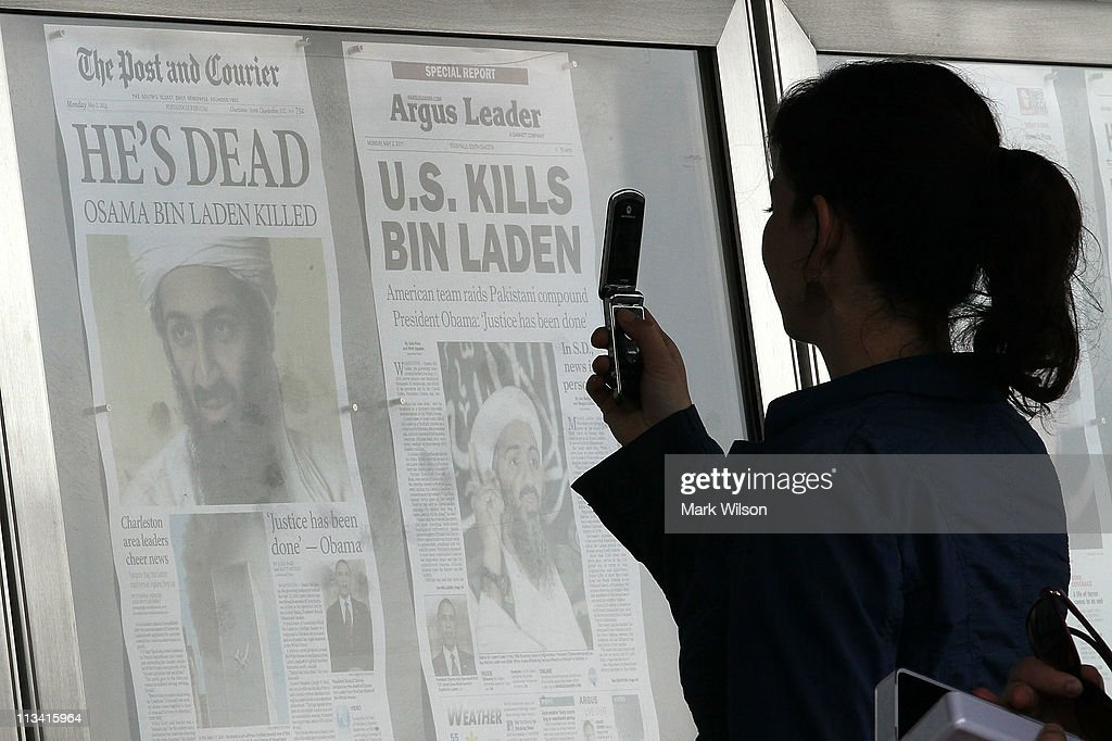 A passerby takes pictures of newspaper headlines reporting the death of Osama Bin Laden, in front of the Newseum, on May 2, 2011 in Washington, DC. Last night U.S. President Barack Obama announced that the United States had killed the most-wanted terrorist Osama Bin Laden in an operation led by U.S. Special Forces in a compound in Abbottabad, Pakistan.