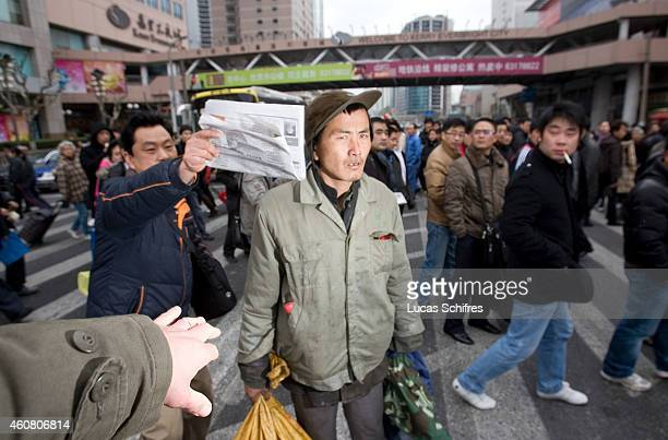 A passerby tries to prevent Wu Wenyi's photograph to be taken on February 17 2009 in Shanghai China Hostile passersby repeatedly stopped us to take...