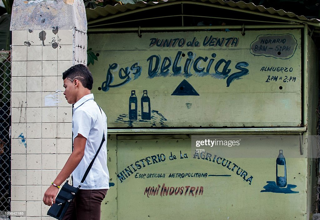 A passer-by walks in front of a closed food establishment in Cerro Municipality, on January 15, 2013 in Havana, following a cholera outbreak. The official newspaper Granma announced today a new cholera outbreak that has allegedly sickened 51 people in Havana.