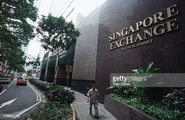 A passerby walks in front of the Singapore Stock Exchange on Cecil Street Singapore has grown to become a major financial hub both regionally and...
