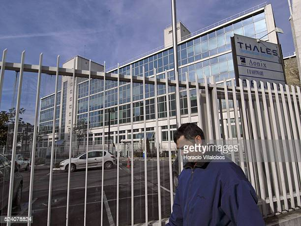 A passerby walks past the headquarters of French communications company Thales whose subsidiary Thales Spectrum de Argentina has been accused by the...