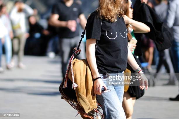 A passerby wears a black tshirt with printed eyes on May 21 2017 in Paris France