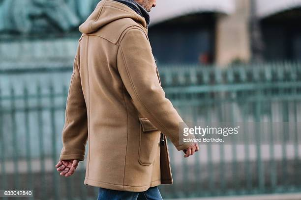 A passerby wears a camel coat on January 29 2017 in Paris France