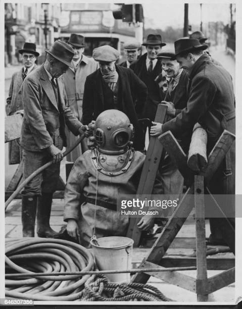Passers by in the busy Bayswater road at Lancaster Gate had the unexpexted sight of a deep dea diver complete with the domed helmet and rubber suit...
