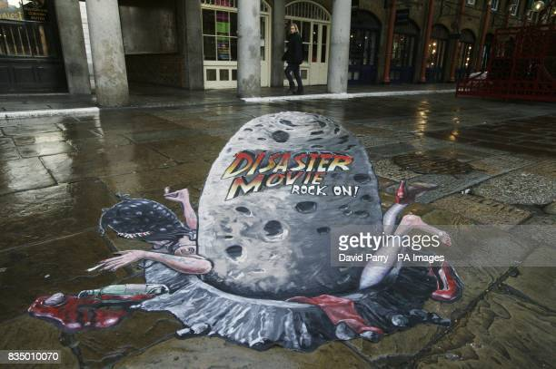 Passersby enjoy some 3D pavement art by artist Joe Hill in Covent Garden London to mark the launch of Disaster Movie the latest slapstick spoof hit...