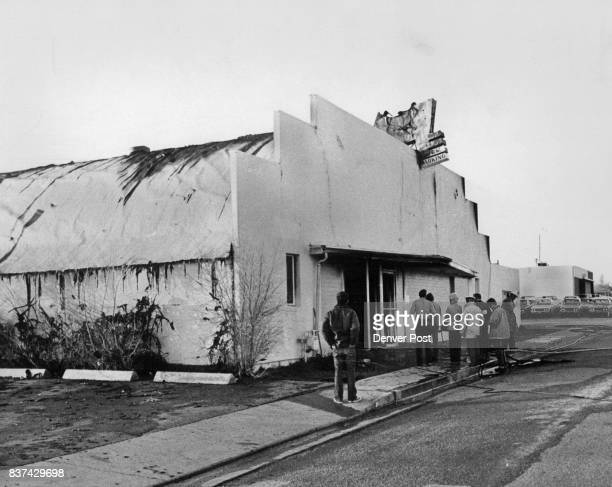 Passersby Look Over Burned Building A fire of undetermined origin inflicted heavy damage on the Aurora Lanes 1456 Dallas St bowling alley early...
