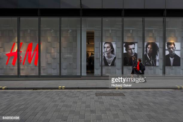 Passersby walk along the street outside an HM retail shop on 16th February 2017 in the City of London England
