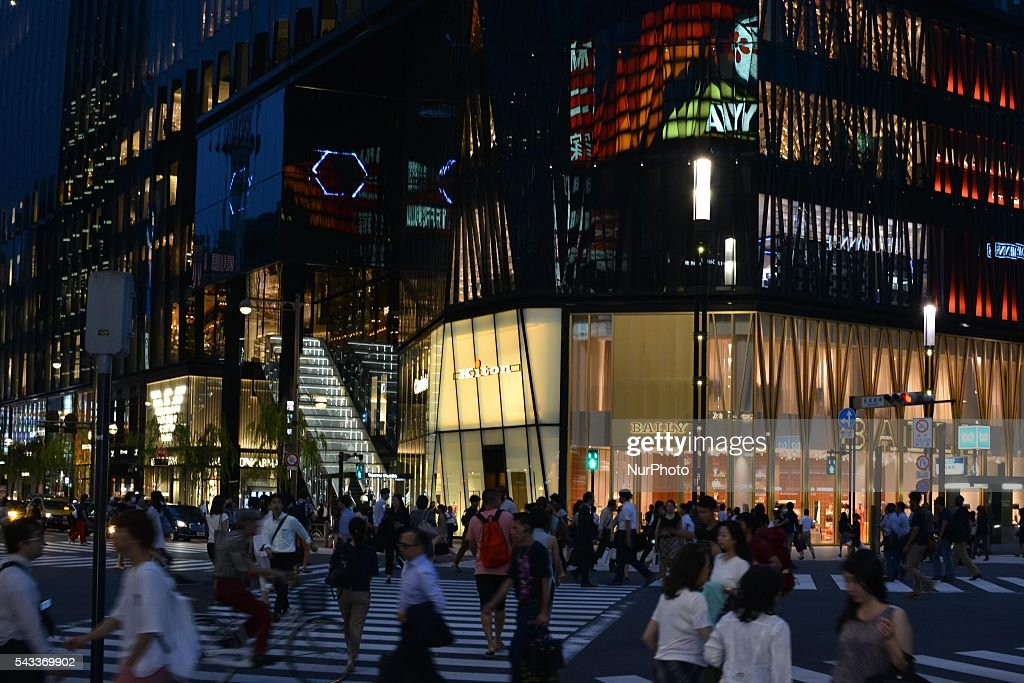 Passersby walk past in front of the Tokyu Plaza Ginza in Tokyo, Japan June 27, 2016. It is one of the largest scale retail structures in Ginza with a total of 125 stores.