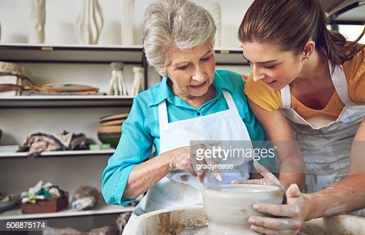 Passing on her pottery skills to Mom