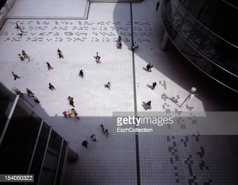 Passing people creating a heart shaped composition : Stock Photo