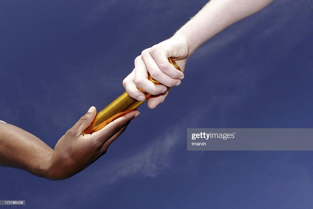 Passing the baton : Stock Photo