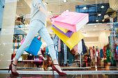 Female walking in shopping mall
