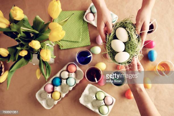 Passing unpainted eggs across the table. Debica, Poland