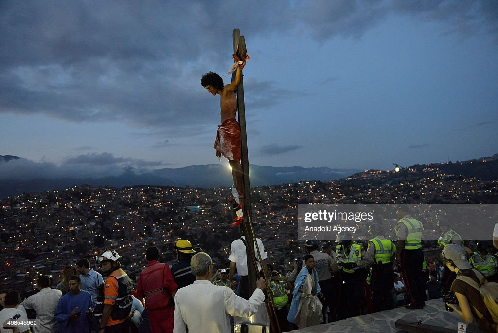 A passion play is displayed as Christians around the world celebrate Holy Week in the Petare town Caracas on April 3 2015 Christians are marking the...
