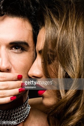 Passion - Woman covering man's mouth