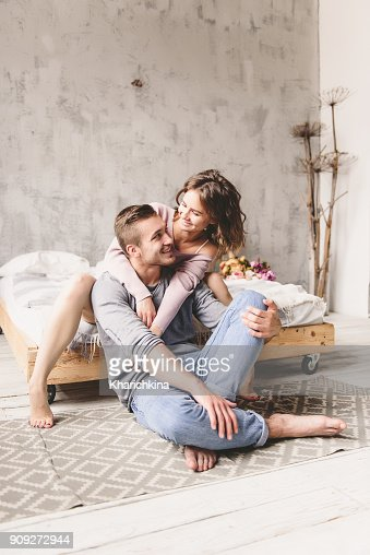 Passionate Beautiful Couple In Bedroom Enjoying Foreplay Stock Photo