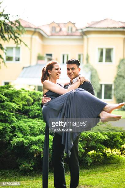 passionate couple embracing for the wedding party