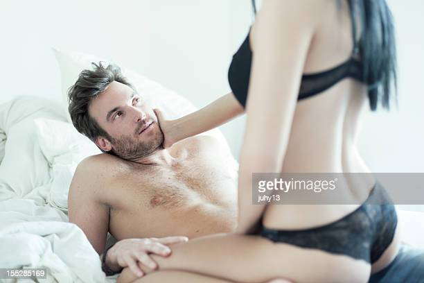 man and woman in bed without clothes