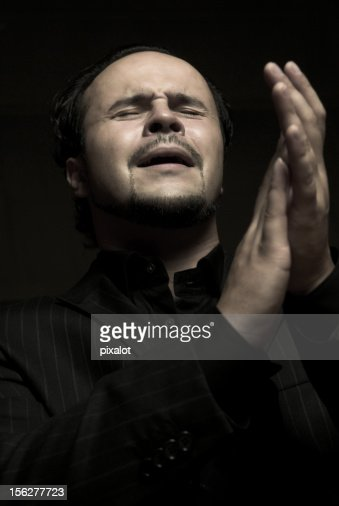 Passionate Man Clapping and Singing : Stock Photo