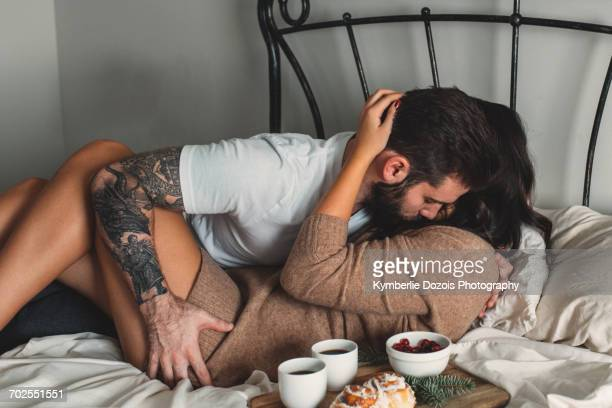 Passionate young couple with breakfast in bed