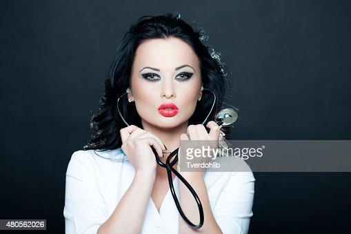 Passioned nurse with phonendoscope : Stock Photo