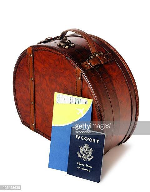 passport and airline ticket with luggage