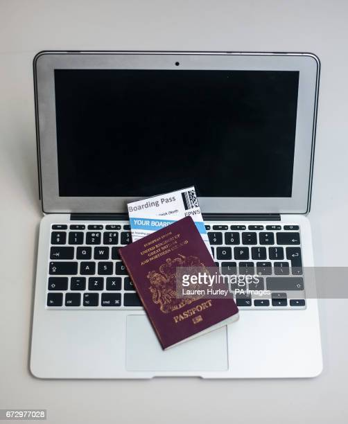A passport containing airline boarding passes on top of a laptop The UK and US have banned large electronic devices including laptops and tablets in...