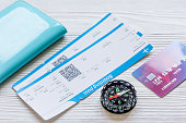 passport, credit card, tickets on wooden background close up