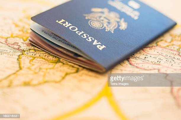 Passport sitting on antique map