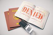 Passport with red denied visa stamp on grey background. Topview. Travel concept, 3D Rendering